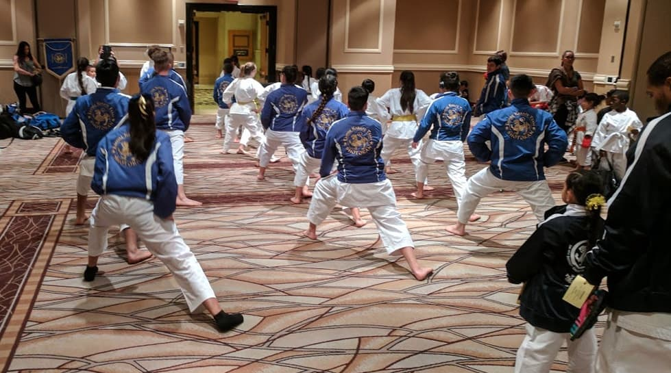 karate team stretching at the tournament